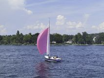 A Purple Sailing Boat Sailing on The Lake Of Constance stock photo
