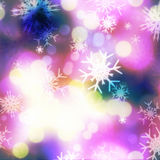 Purple bokeh and snowflakes Stock Image