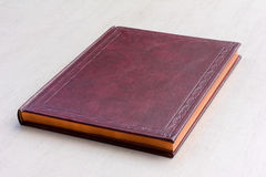 Purple book with gold pages on the gray background Royalty Free Stock Images