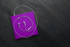 the purple book and white headphones Royalty Free Stock Photo