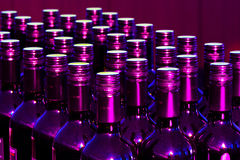 Purple bottles. In a row Royalty Free Stock Photos
