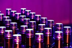 Purple bottles. In a row Stock Photos