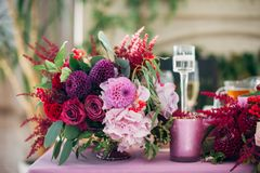 Purple bouquet of asters, roses and dahlias. In purple, red and pink flowers Stock Photo