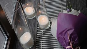 Purple bouquet of flowers and candles as a wedding decoration. Close up stock video