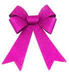 Purple Bow. Purple glitter Christmas bow on white background Royalty Free Stock Photography