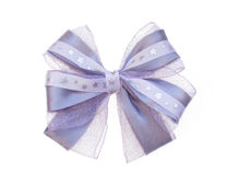 Purple bow close up Stock Photography