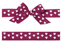 Purple bow and ribbon. Purple bow with hearts and ribbon Stock Images
