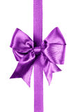 Purple bow made from silk ribbon Stock Images