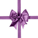 Purple bow made from silk ribbon Royalty Free Stock Images