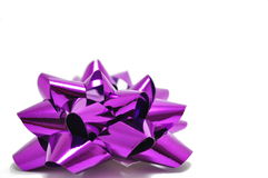 Purple Bow Ribbon. Puple Bow against a white background. The light shines from this bow that brings to thought the brightness of evry gift we give and receive royalty free stock image