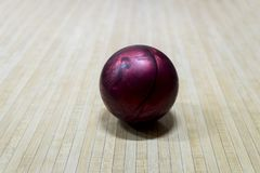 Purple bowling ball on the track in the bowling center royalty free stock image