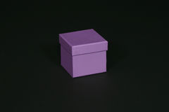 Purple box. On black background Stock Images