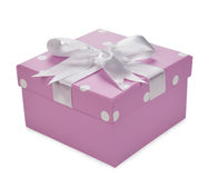 Purple box decorated with ribbon Stock Images