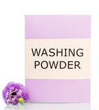 Purple box with washing powder and flower isolated on white background Stock Images