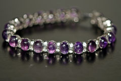 Purple bracelet Stock Image
