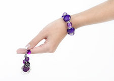 Purple bracelet and earring Stock Photos