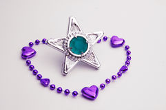 Purple bracelet with a star gem Stock Images