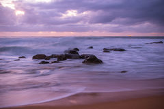 Purple Break of Dawn Seascape. Long Exposure at Killcare Beach, Central Coast, NSW, Australia Royalty Free Stock Image
