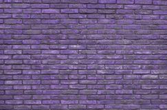 Purple brick wall background, wallpaper. Purple bricks pattern, texture. Purple web backdrop stock photography