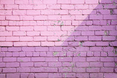 Purple brick wall. Dark ang light stock photography