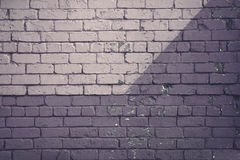 Purple brick wall. Light and dark Royalty Free Stock Image