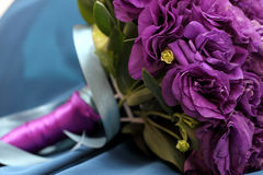 Purple bridal bouquet. Of flowers on blue background Royalty Free Stock Photography