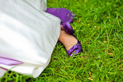 Purple bride shoes on green grass Stock Photography