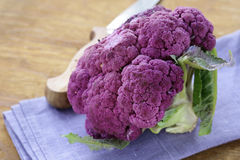 Purple broccoli on a wooden table Royalty Free Stock Photography