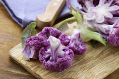 Purple broccoli on a wooden table Royalty Free Stock Photo
