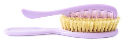 Purple brush and comb isolated on white stock photo