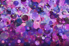 Purple bubbles and stars abstract holiday background. Stock Images
