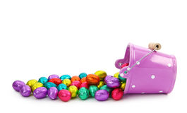 Purple bucket and easter chocolate eggs Stock Image