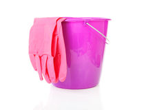 Purple bucket and household gloves Stock Photos