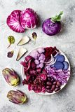 Purple Buddha bowl with spiral carrots, cauliflower, beet, onion, potato, shredded red cabbage, radicchio salad, kalamata olives. Vegan detox veggie bowl Royalty Free Stock Images
