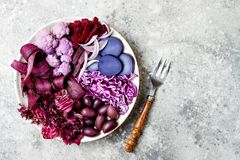 Purple Buddha bowl with spiral carrots, cauliflower, beet, onion, potato, shredded red cabbage, radicchio salad, kalamata olives. Vegan detox veggie bowl Stock Photography