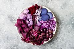 Purple Buddha bowl with spiral carrots, cauliflower, beet, onion, potato, shredded red cabbage, radicchio salad, kalamata olives. Vegan detox veggie bowl Stock Image