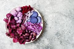 Purple Buddha bowl with spiral carrots, cauliflower, beet, onion, potato, shredded red cabbage, radicchio salad, kalamata olives. Vegan detox veggie bowl Royalty Free Stock Photos