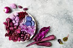 Purple Buddha bowl with spiral carrots, cauliflower, beet, onion, potato, shredded red cabbage, radicchio salad, kalamata olives. Vegan detox veggie bowl Royalty Free Stock Photo