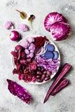 Purple Buddha bowl with spiral carrots, cauliflower, beet, onion, potato, shredded red cabbage, radicchio salad, kalamata olives. Vegan detox veggie bowl Royalty Free Stock Photography