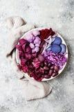 Purple Buddha bowl with spiral carrots, cauliflower, beet, onion, potato, shredded red cabbage, radicchio salad, kalamata olives. Vegan detox veggie bowl Royalty Free Stock Images