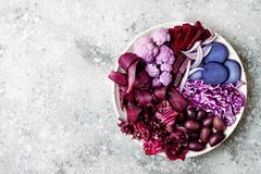Purple Buddha bowl with spiral carrots, cauliflower, beet, onion, potato, shredded red cabbage, radicchio salad, kalamata olives. Vegan detox veggie bowl Stock Images