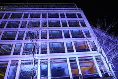 Purple building. Front view of an office building at night under purple decorative lights Stock Images