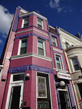 Purple Building in Adams Morgan. Photo of purple building in adams morgan in washington dc on 9/13/15. This diverse neighborhood has many restaurants and retail stock photography