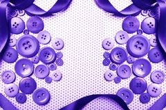 Purple buttons with ribbon background. Various purple buttons over violet and ribbon backround with copy space and polka dots Stock Photo
