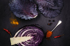 Purple cabbage on black table Royalty Free Stock Photos