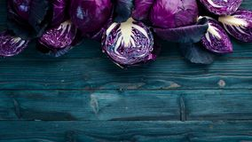 Purple cabbage on a blue wooden background. Organic food. Top view. Free space for your text royalty free stock photos
