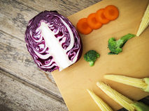Purple cabbage broccoli carrot baby corn vegetable on wooden stock photos