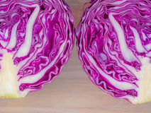 Purple cabbage on cutting boards on Wooden table . Stock Image