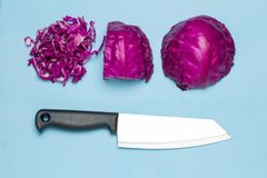 Purple Cabbage half and slice. knife. isolated on white backgrou Stock Photos
