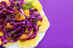 Purple cabbage salad with tangerines Royalty Free Stock Photo